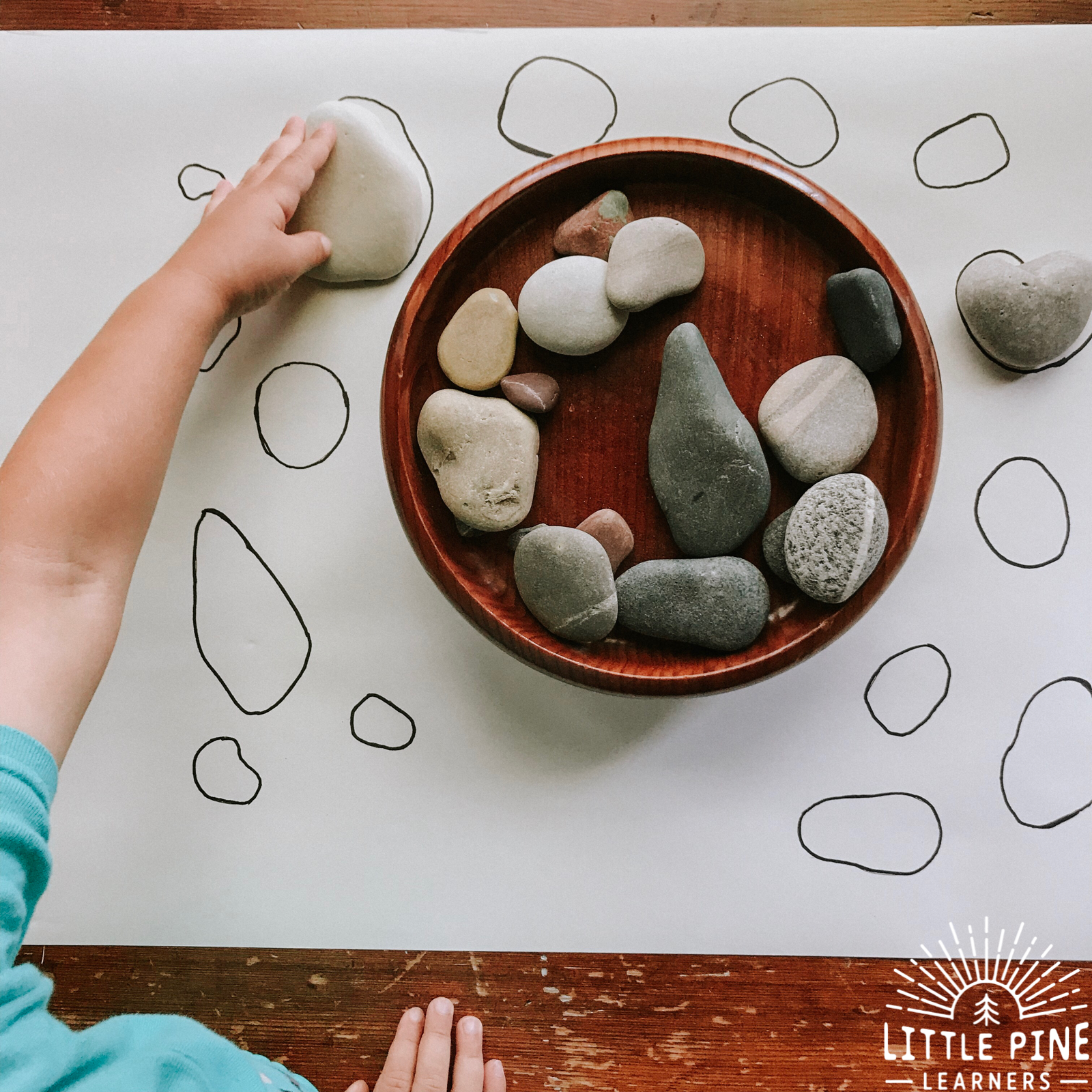 Try this simple stone matching game today! This game will give your child the opportunity to practice using new vocabulary words, compare different sizes and shapes, strengthen fine motor skills, and appreciate nature in a new way!