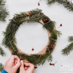 Try making this simple and adorable Christmas wreath for kids with real pine branches and cardboard!