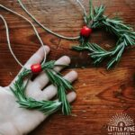 This absolutely adorable mini rosemary wreath necklace is a must have accessory for kids this holiday season!
