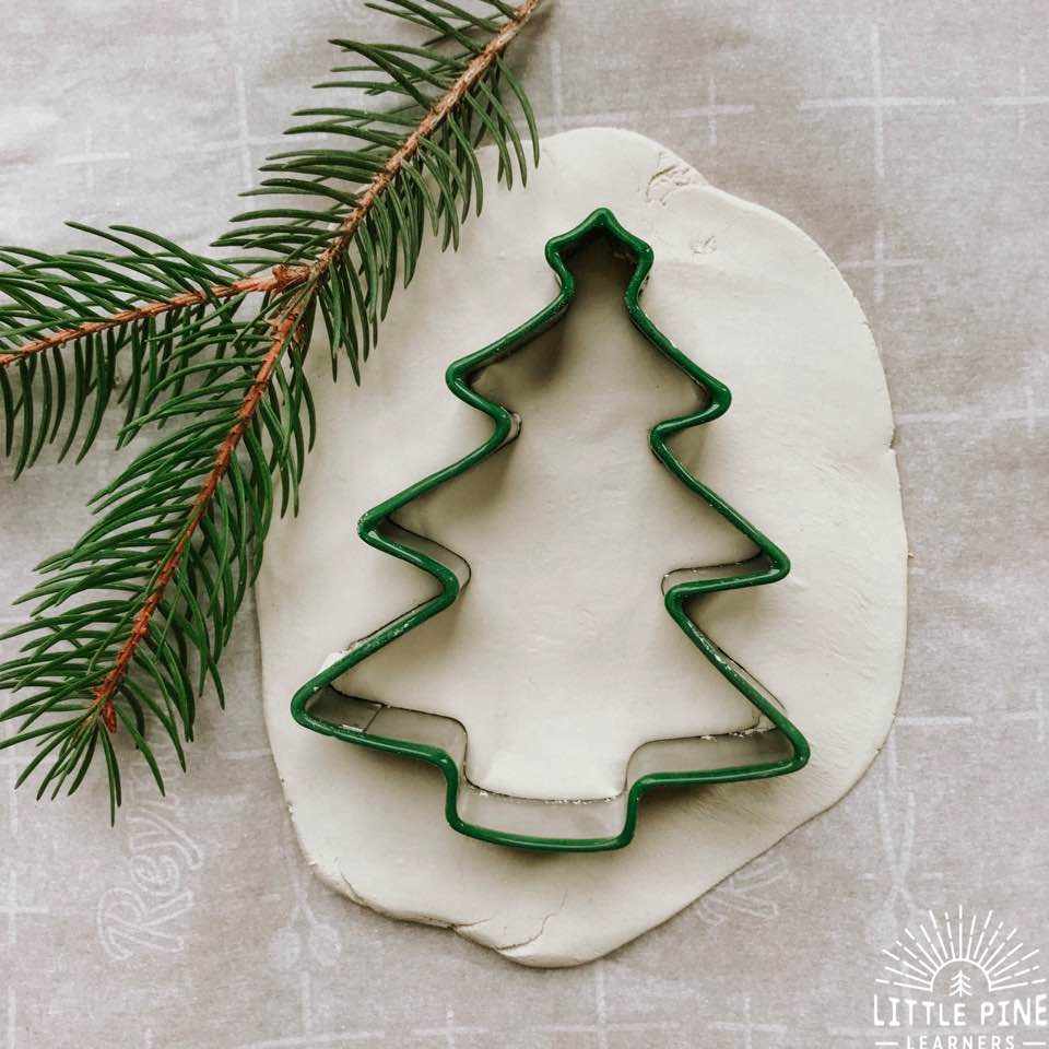 Here is a simple and beautiful keepsake ornament to make with kids. Kids will love making pretty pine needle designs on the ornaments and these little pieces of art will become a special reminder of this holiday season! Just pick a few pine needles off your tree (or off the floor), add a couple more supplies and you are all set to make this ornament you will treasure forever.