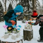 The next time you're a looking for a fun and easy outdoor winter activity for kids, try making a magical snow garden! It's so easy to set up and kids of all ages will love making different floral arrangements in the snow. The flowers look so beautiful against the white snow and make a really fun and colorful outdoor decoration!