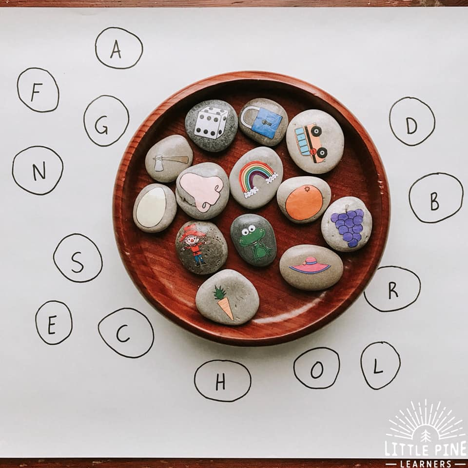 Try making beginning sound stones today! They are a versatile early literacy learning tool and so fun to use. Kids will love matching up the pictures on the beginning sound stone to the letter outline and get a great sense of satisfaction when they see their completed work.