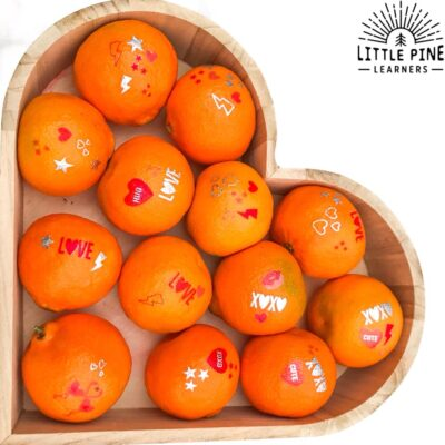 Try this adorable snactivity for Valentine's Day! These decorated cutie oranges are a great healthy alternative to the junk food and candy that kids pass out on Valentine's Day. Give this a try today! Kids will love to help make these sweet little gifts.
