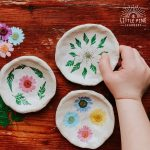 Try making these pretty pinch pots with flowers and leaves!