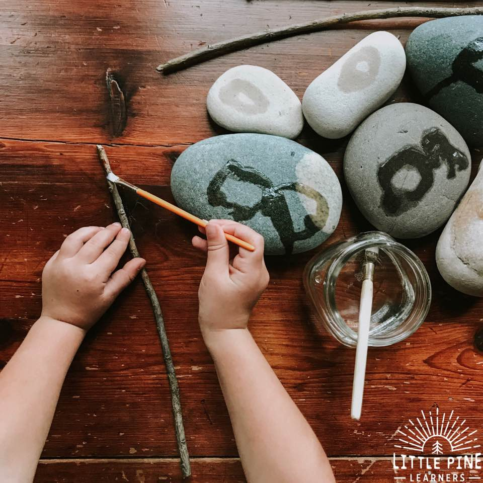 Paint on sticks and stones with water