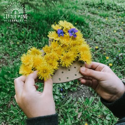 Try this fun fine motor activity this spring! Just grab a fistful of dandelions and start threading them on your DIY board. This is the perfect activity for reusing extra pieces of cardboard that you have laying around the house. Spring is the perfect time for nature activities! Get outside and give this one a try with your kids.