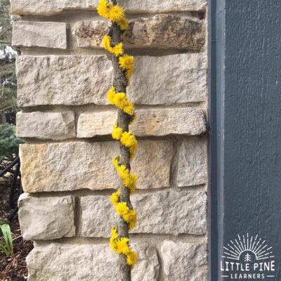 Here's a fun hiking accessory that will keep kids moving and exploring on the hiking trail. Try this activity when you want to get your kids outdoors in the spring. These dandelion hiking sticks are super easy to make and look beautiful when complete!